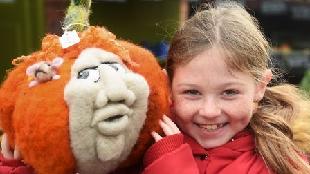 Abigail Gage, eight, meets a pumpkin friend on the Feltlikeit stall at the Stalham Yuletide Market.
