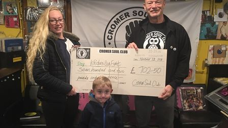 Trevor Bailey presents the proceeds from a charity Northern Soul night at Cromer Soul Club to Kyra W