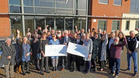 North Norfolk MP Norman Lamb (front centre) and Victory Housing Trust director of housing Christine