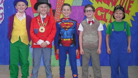 Year 5 cast member on stage in the Cromer Junior School production of The Amazing Adventures of Supe