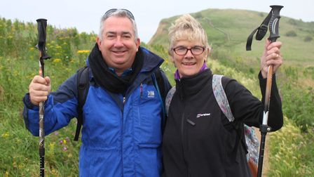 Hilary Cox and Barry Foulsher in training at north Norfolk landmark Beeston Hill for their trek up t
