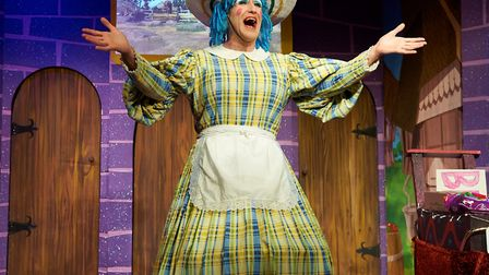 Mrs Pans (James Lavender) in full song in Sheringham Little Theatre's Beauty and the Beast panto. Pi