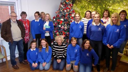 Hospital Friends members with the Broadland Youth Choir after the singing session. Photo: Richard Ba