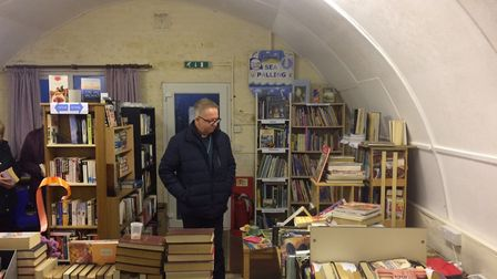 The Bishop of Thetford browsing at the new Sea Palling community library. Pictures: David Bale