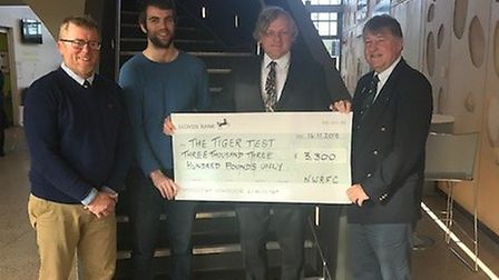 Donation towards the Tiger Test project. L-R, Alan Hepburn, Shea Connell, Professor Colin Cooper, an