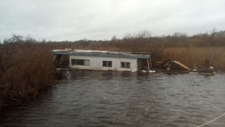 The sunken houseboat. Picture: Miles Weston