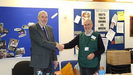 Rotary club president Terry Sands, left, presented David Connolly Hart, team leader at Cromer and Di
