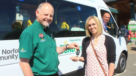 Morrisons Cromer community champion handing over the keys to a new minibus to North Norfolk Communit
