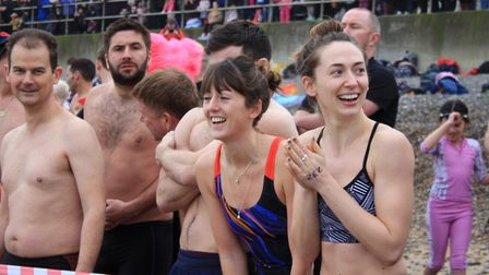 Swimmers line up on the beach for Sheringham's annual New Year's Day dip.Photo: KAREN BETHELL