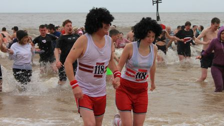 Intrepid swimmers brave the waves at Sheringham's annual New Year's Day dip.Photo: KAREN BETHELL