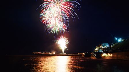 Fireworks light up the night sky in Cromer, to celebrate New Year's Day. Picture: Ian Burt