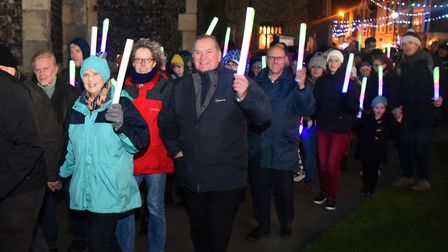 The Cromer New Year's Day torchlight procession leaves the Church heading to the beach for the firew