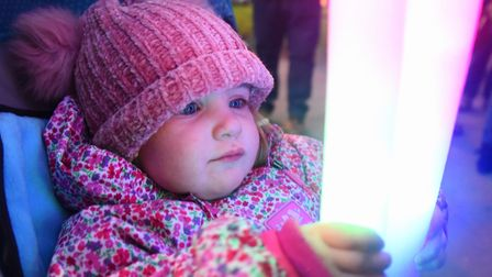 Two-year-old Grace Shearing taking part in the Cromer New Year's Day torchlight procession. Picture:
