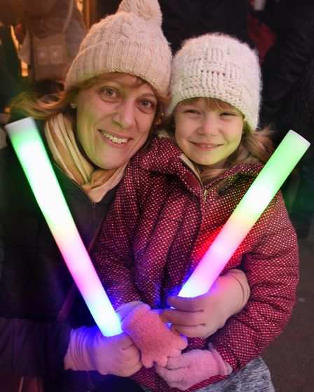 Catherine Dolton and her daughter Lauren, six, taking part in the Cromer New Year's Day torchlight p