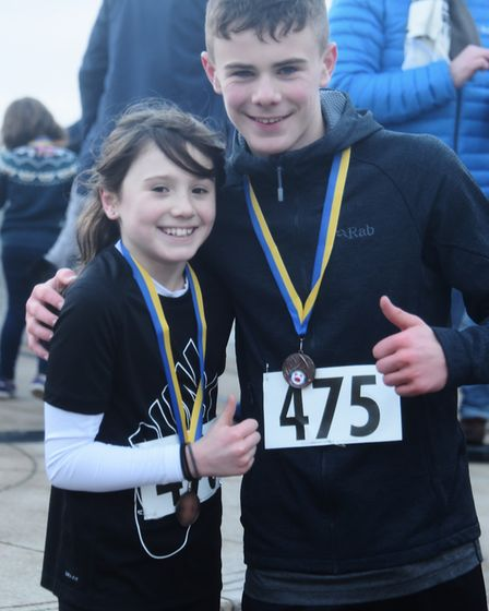 Winner of the New Year's Day family fun run at Cromer, Stanley Clarke, 15, and his sister, Iris, 11,