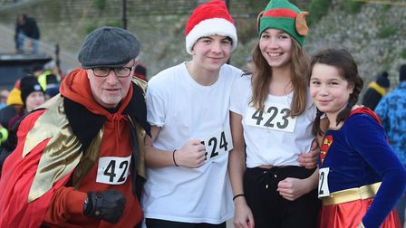 A family taking part in the New Year's Day family fun run at Cromer, from left, John Allerhand, Chri