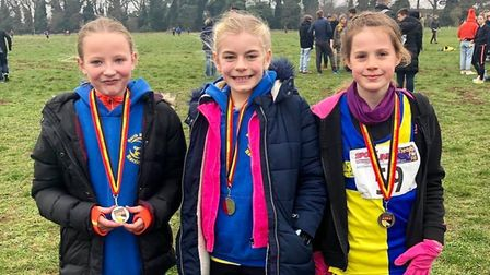 The Under-11 girls team (left to right) Eloise Edridge, Olivia Allen and Rosie Dickety with their si