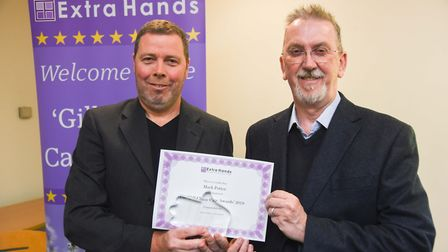 Mark Potter, left, with David Evans. Mr Potter, a carer from Cromer, was presented with an award at