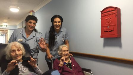 Overbury House residents pictured with two of the home's care workers. Photo: Overbury House
