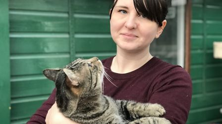 Volunteer Louise Piper with cat Sid at North Norfolk Cats Lifeline Sanctuary in Sheringham. Picture: