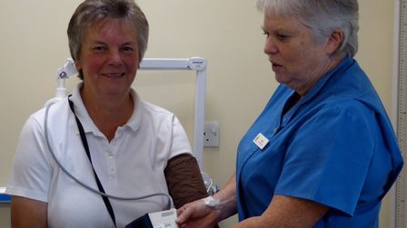 PPG chairman Liz Hewett (left) and health care assistant Tracey Mathews with the new 24-hour blood p