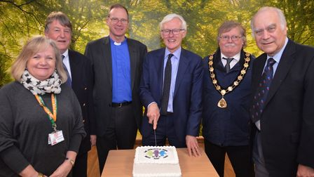 MP Norman Lamb joins hospital Friends and supporters to cut the cake to mark the opening of the new