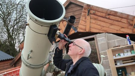 Andrew Glossop from the North Norfolk Astronomy Society peers through the sight on the society's tel