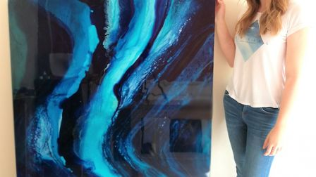 Amelia Mills with her work, Illuminated Deep. Pictures: supplied by NNDC