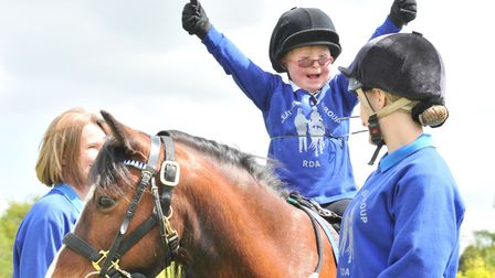 A youngster enjoys riding with the Riding for the Disabled Association. Picture: RDA