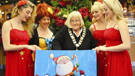 Gwen Smith, centre, drawing a prize during her tenue as Cromer's mayor in 2012, assisted by performe