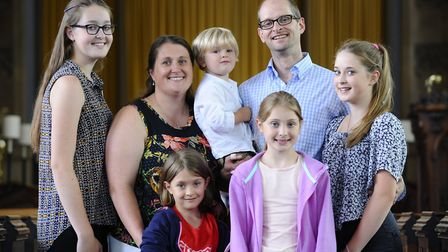 The vicar of Cromer, Rev Dr James Porter with his wife Katie and five of their six children, picture