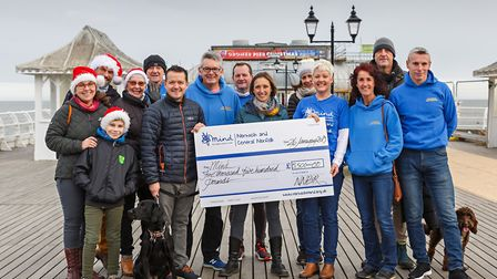 Mind cheque from Boxing Day dip. L-R, Helen Jewers, William Jewers, Terry Cutler, Mary Cutler, Mearl