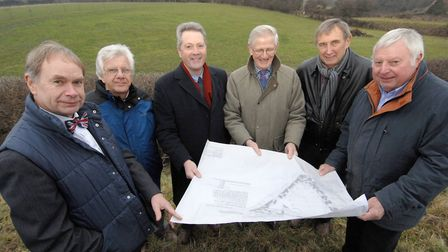 Philip High, second from left, and others look at plans for a possible car park off Thornage Road in