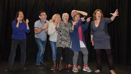 Participants in an improv course 'watch' a horse race, coached by tutor Danny O'Hara (far right). A