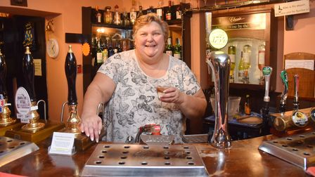 Julie Oatham is back behind the bar at The Butchers Arms pub in East Ruston after someone saved the