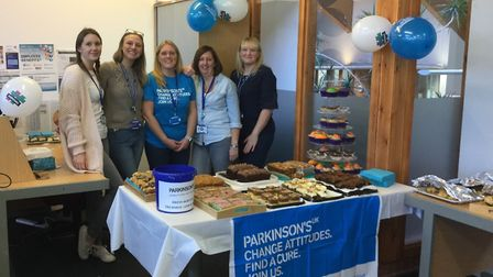 North Norfolk District Council staff members taking part in a dress down day and bake sale for Parki