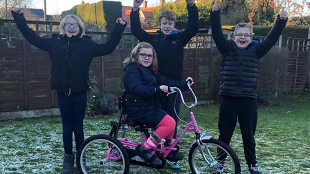 Felicity Wright on new trike with her siblings. Pictures: supplied by Sarah Wright