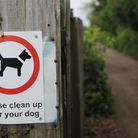 A sign asks dog owners to pick up after their pets. Picture: Chris Bishop