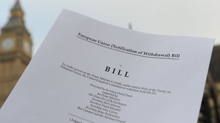 A copy of the Bill to trigger article 50, in front of the Houses of the Parliament in London.