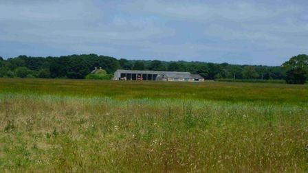 View of Warren Farm Barns against woodland backdrop. Picture: Planning Documents