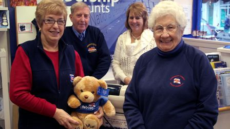 Mary Blyth (right) pictured with Sheringham RNLI charity shop staff and volunteers when the High Str