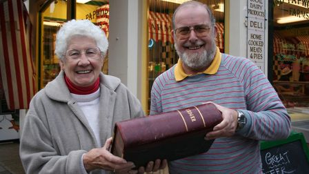 Local history enthusiast Brian Alton handing over Co-operative Street butcher Reg Pope's 1939-40 led