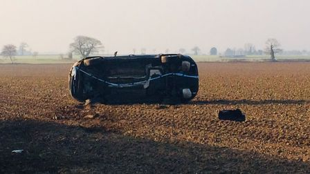 Car off the road in a field near Thorpe Market. Pictures: David Bale