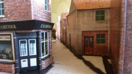 Photo of the model taken at a similar angle to an old photo of the yard as a comparison. Pictures: R