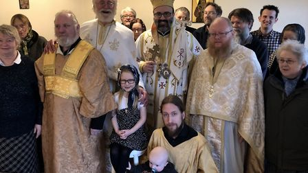 The Bishop, two Priests, Sub-Deacon, Reeader-in-training, and new arrival baby Noah. Photo: William