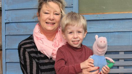 Former nurse Sandra Telford with her four-year-old grandson Harry, who defied the odds despite being