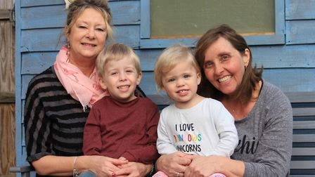Four-year-old Harry Morris with nannies Sandra Telford (left) and Theresa Ward and little sister Flo