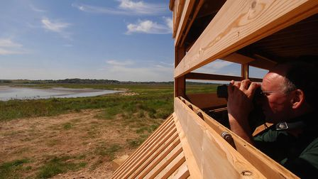 Bernard Bishop, inside a newly-opened hide at Cley Marshes in 2007. Picture: Robyn Greenacre