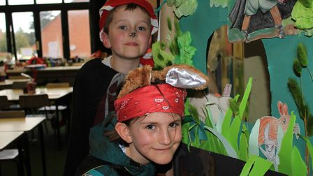 Nine-year-olds Charlie and Isabelle join in World Book Day celebrations held at Sheringham Primary S