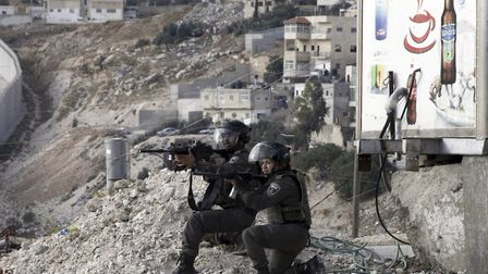 Israeli border policemen in the West Bank. Yisrael Medad says Israeli settlements have not been buil